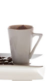 Cup with coffee and beans close up Royalty Free Stock Photos