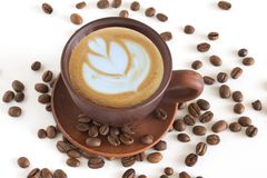 Cup of coffee, and coffee beans close up on a white background stock photography