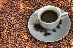 Cup and coffee beans Stock Photography