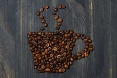 Cup of coffee beans, concept photo, closeup Stock Image