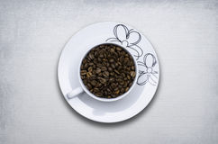 Cup of coffee beans concept Royalty Free Stock Photography
