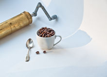 Cup, coffee beans and copper manual mill. Stock Images