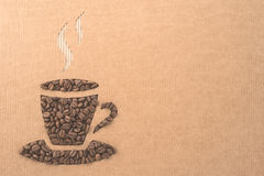 Cup with coffee beans. On corrugated board Stock Photography