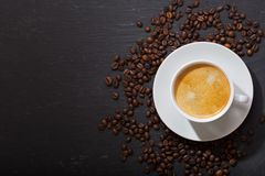 Cup of coffee and coffee beans on dark background stock photo