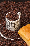 Cup and coffee beans Royalty Free Stock Photo