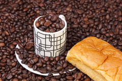 Cup and coffee beans Stock Images