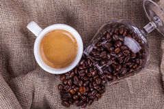Cup of coffee and beans Stock Photography
