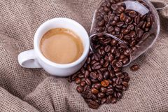 Cup of coffee and beans Royalty Free Stock Images