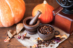 Cup of coffee with beans and grinder. Stock Image