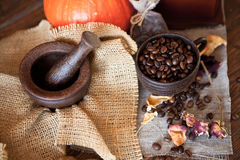 Cup of coffee with beans and grinder. Royalty Free Stock Images