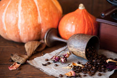 Cup of coffee with beans and grinder. Royalty Free Stock Photo