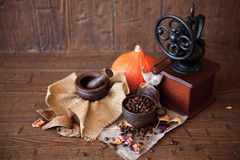 Cup of coffee with beans and grinder. Stock Images