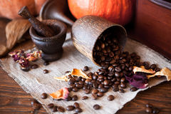Cup of coffee with beans and grinder. Stock Photos
