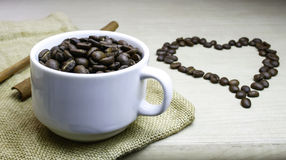 Cup of coffee beans with heart coffee beans Stock Photo