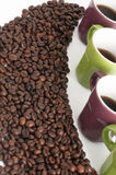 Cup of coffee with beans Royalty Free Stock Photos