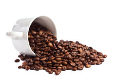 Cup of coffee beans isolated Stock Image