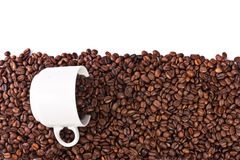 Cup of coffee beans isolated Stock Photography