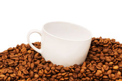 Cup and coffee beans isolated Stock Images