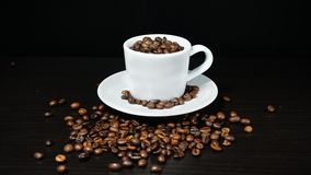Cup With Coffee Beans Isolated on Black Background.  Stock Photos