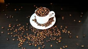 Cup With Coffee Beans Isolated on Black Background.  Stock Images