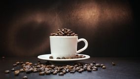 Cup With Coffee Beans Isolated on Black Background.  Royalty Free Stock Image