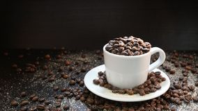 Cup With Coffee Beans Isolated on Black Background.  Stock Photography