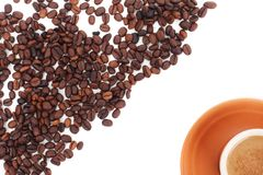 Cup and coffee beans isolated over white Royalty Free Stock Photo