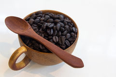 Cup with coffee beans isolated. On white background Royalty Free Stock Photos
