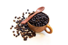 Cup with coffee beans isolated on white background. Cup with coffee beans isolated on white background and spoon Stock Photography