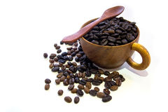 Cup with coffee beans isolated on white background. Cup with coffee beans isolated on white background and spoon Royalty Free Stock Photography