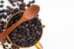 Cup with coffee beans isolated on white background. Cup with coffee beans isolated on white background and spoon Royalty Free Stock Photos