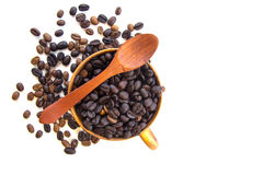 Cup with coffee beans isolated on white background. Cup with coffee beans isolated on white background with spoon Stock Photography