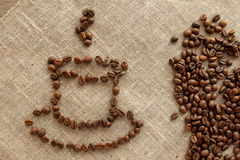 Cup of coffee beans on linen top view Stock Photography