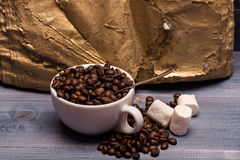Cup of coffee beans, marshmallows and book Obraz Stock