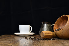 Cup of coffee, beans and mortar with pestle Royalty Free Stock Images