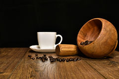 Cup of coffee, beans and mortar with pestle Royalty Free Stock Photos