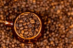 Cup of coffee beans, on old rusty background. Soft focus, copy space. stock photo