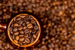 Cup of coffee beans, on old rusty background. Soft focus, copy space. stock image