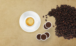 Cup of coffee with beans and pods on marble table Stock Photo
