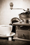 Cup of coffee, beans, pot and grinder on wood Stock Image