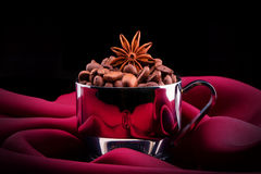 Cup of Coffee with beans on red silk Royalty Free Stock Photo