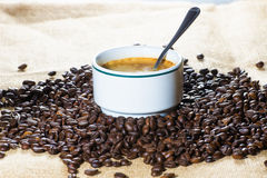 Cup of coffee and beans in sack Royalty Free Stock Images