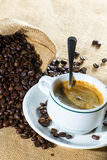 Cup of coffee and beans in sack Royalty Free Stock Photos