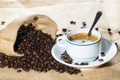 Cup of coffee and beans in sack Royalty Free Stock Photo