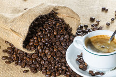 Cup of coffee and beans in sack Royalty Free Stock Photography