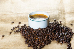Cup of coffee beans in sack Stock Photography
