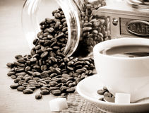 Cup of coffee and beans on sepia Royalty Free Stock Photos
