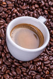 Cup on coffee beans Stock Photography