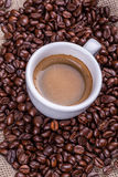 Cup of coffee and beans Royalty Free Stock Image