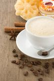 Cup of coffee with beans and sweets Royalty Free Stock Photography